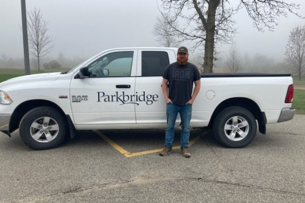 Ryan Foss standing next to his Parkbridge company truck